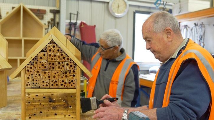 Gentlemen making beehives