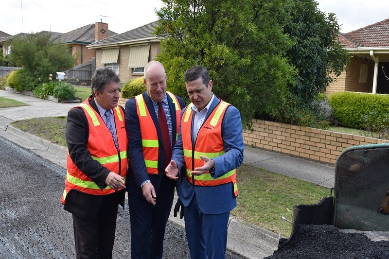 Three gentlemen at the launch of the Hume rubbish to roads project