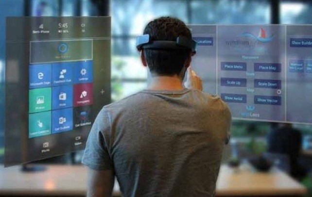 Man wearing HoloLens interacting with virtual environment